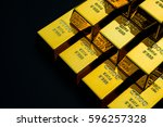 gold bar on a black background | Shutterstock . vector #596257328