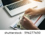 male freelancer counting money... | Shutterstock . vector #596277650