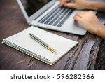 woman hand using laptop... | Shutterstock . vector #596282366