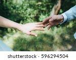 walking wedding couple in the... | Shutterstock . vector #596294504