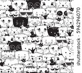 Stock vector seamless pattern with doodle cats cats head animal pattern can be used for textile website 596296070