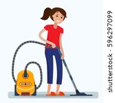 woman cleaning home with vacuum ... | Shutterstock .eps vector #596297099