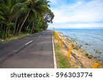empty coastal road by the sea.... | Shutterstock . vector #596303774