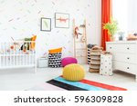 white cradle and colorful poufs ... | Shutterstock . vector #596309828
