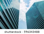 high rise buildings and blue sky | Shutterstock . vector #596343488