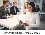 happy business colleagues...   Shutterstock . vector #596364410