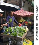 Small photo of HANOI, VIETNAM 13TH DECEMBER 2016, hawker selling fruits and food at the local street of Hanoi