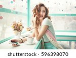 happy smiling young woman using ... | Shutterstock . vector #596398070