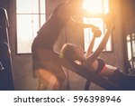 sporty girl doing weight... | Shutterstock . vector #596398946