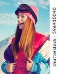 happy girl removes ski jacket   ... | Shutterstock . vector #596410040
