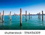 wooden poles in giudecca canal  ... | Shutterstock . vector #596456309