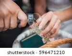 a man pours champagne to a woman | Shutterstock . vector #596471210