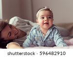beautiful baby girl and her... | Shutterstock . vector #596482910