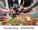 people clinking glasses with... | Shutterstock . vector #596490590