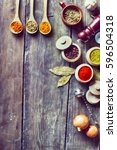 herbs and spices wooden table | Shutterstock . vector #596504318