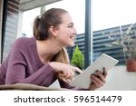 happy beautiful young woman... | Shutterstock . vector #596514479