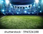 football pitch and blue lights  | Shutterstock . vector #596526188