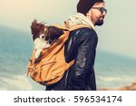 travel hipster man with dog ... | Shutterstock . vector #596534174