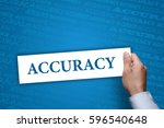 Small photo of Businessman holding Accuracy sing