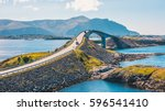 Small photo of World famous Atlantic road bridge (Atlanterhavsvegen) with an amazing view over the norwegian mountains. Atlantic road runs through an archipelago in Eide and Averøy in Møre og Romsdal, Norway.