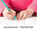 child's hand with  pencil... | Shutterstock . vector #596569184