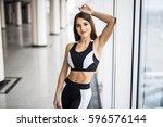 beautiful girl standing in the... | Shutterstock . vector #596576144