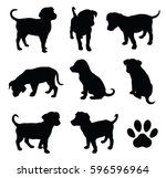 Stock vector vector puppy silhouettes with paw symbol 596596964