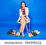 young stylish beautiful woman... | Shutterstock . vector #596598116