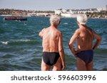 two old men in swimming trunks... | Shutterstock . vector #596603996