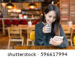 woman looking at cellphone and... | Shutterstock . vector #596617994