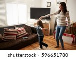 daughter dances with mother at... | Shutterstock . vector #596651780