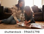 mother and daughter at home... | Shutterstock . vector #596651798