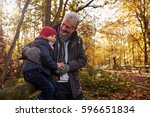 grandfather and granddaughter...   Shutterstock . vector #596651834