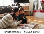 mother and daughter at home... | Shutterstock . vector #596651840