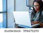 attractive young businesswoman... | Shutterstock . vector #596670293