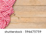 table cloth red on wood... | Shutterstock . vector #596675759