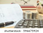row of coins pen and calculator ... | Shutterstock . vector #596675924