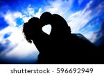couple kissing under a dramatic ...   Shutterstock . vector #596692949