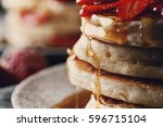 food. delicious pancakes on a... | Shutterstock . vector #596715104