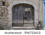 old wooden door in a village | Shutterstock . vector #596722613