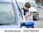 young caucasian boy is busy... | Shutterstock . vector #596730344
