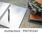blank notebook with pen and... | Shutterstock . vector #596745164
