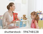 cute little girl at speech... | Shutterstock . vector #596748128