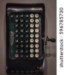 Small photo of The fragment of old and vintage adding machine.