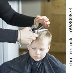 male child at the barber shop... | Shutterstock . vector #596800874