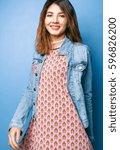 beautiful positive girl in a... | Shutterstock . vector #596826200