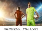 soccer players on a soccer field | Shutterstock . vector #596847704