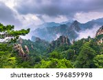 peak of the yellow mountains ... | Shutterstock . vector #596859998