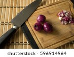 red onions chopped on chopping... | Shutterstock . vector #596914964