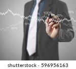 businessman drawing graphics a... | Shutterstock . vector #596956163